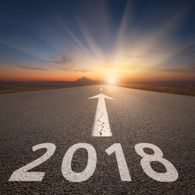 Image of an empty highway with 2018 and an arrow written on it.