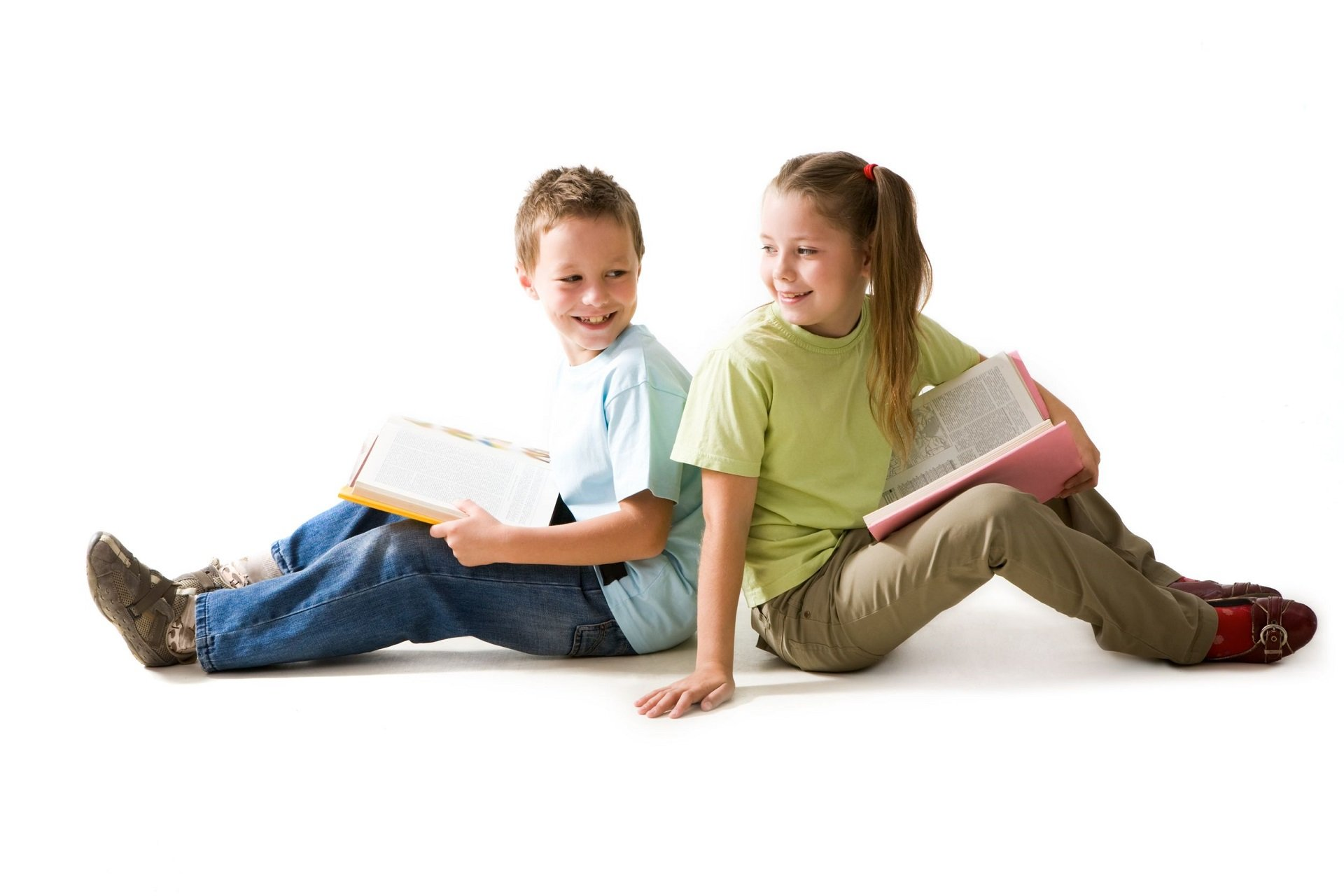 An image of two children reading books