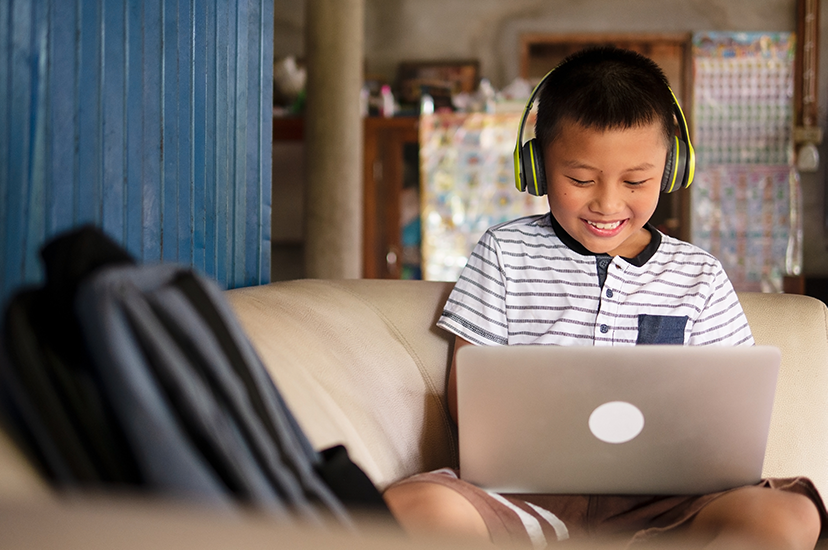 boy on laptop for distance learning or remote learning or hybrid learning making reading gains with Fast ForWord